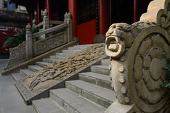 Stone dragon on balustrade before ancient Chinese building Stock Image