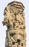Stone dragon carving pillar. Royalty Free Stock Photography