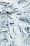 Stone dragon sculpture wall Stock Images