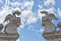 Stone dragon statue. On the blue sky background Stock Images