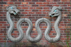 Stone dragon. A View of a two headed stone dragon with two heads stock photo