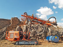 Stone drilling tractor. At noon Stock Image