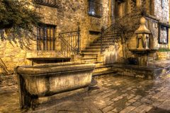 Stone drinking trough and fountain. In the old town of Valbonne in the south of France Royalty Free Stock Image