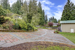 Stone driveway and garage Royalty Free Stock Photo