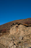 Stone dwelling. House constructed chiefly with stacking rock slates on top of each other. Located in Aba prefecture in Sichuan, China Royalty Free Stock Image