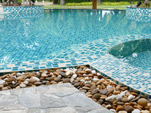 Stone on the edge of the swimming pool Royalty Free Stock Photos