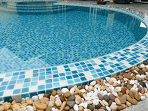 Stone on the edge of the swimming pool Royalty Free Stock Image