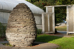 Stone Egg Sculpture and Doorway. Stone egg sculpture near the Durfee Conservatory on the campus of UMass Amherst with doorway in background Royalty Free Stock Images