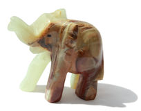 Stone elephant. Souvenir from onyx on a white background Royalty Free Stock Images