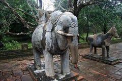Stone elephant and horse Stock Images
