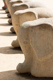 Stone elephants. A row of identical concrete elephants Royalty Free Stock Images