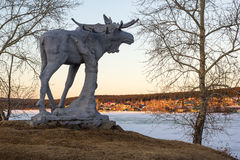 Stone elk. The symbol of the same village in Russia Stock Image