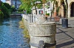 Stone embankment of a small Italian city concept stock photography