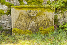 Stone with emblem Stock Photos