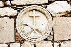 Stone Embossment at Gethsemane. A stone embossment decoration on on a wall in the garden of 'The Church of All Nations' at Gethsemane, the place where Jesus Stock Images