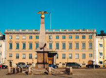 Stone of the Empress is on the background of the building of the Swedish Embassy on Market Square. Stock Images