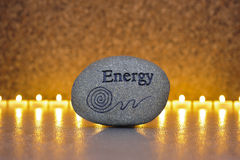 Stone of energy. ZEN stone of energy with line of candles in background Royalty Free Stock Image