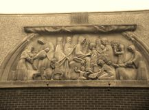 Stone engraving above old church- beautiful Royalty Free Stock Images