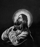 Stone engraving of Jesus. Picture of Jesus engraved in shiny black stone Royalty Free Stock Photography