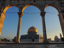 Stone entrance and golden tomb of Al-Aqsa mosque, Jerusalem. This picture captures the stone entrance and the golden tomb of the Al-Aqsa mosque. Al-Aqsa Mosque royalty free stock photo