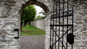 Stone entrance with an old medieval black steel gate Stock Photos