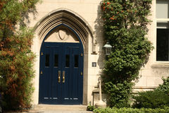 Stone entrance & wooden door. An entrance to Dickinson hall at Princeton University royalty free stock images