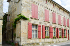 Stone façade of france. With shutters of burgundy color in the city of Bar le Duc in Meuse Française stock images