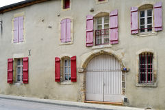 Stone façade of france with shutters. Of burgundy color in the city of Bar le Duc in Meuse Française royalty free stock photography