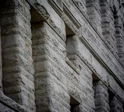 Architectural Façade in a City Setting. Stone façade of a government building with strong architectural lines in a metropolis city setting royalty free stock photography