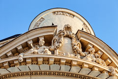 Stone facade on classical building Stock Photos