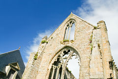 Stone facade of old abbey Stock Photography