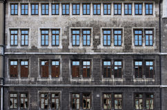 Stone facade with rows of windows Royalty Free Stock Photography