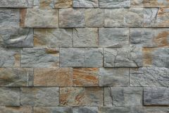 Stone facade tiles. Background texture royalty free stock photo