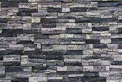 Stone facade wall. Wall facade made of natural granite stone tiles Stock Photography