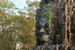 Stone face in ancient Bayon temple, Angkor in Cambodia Royalty Free Stock Photography