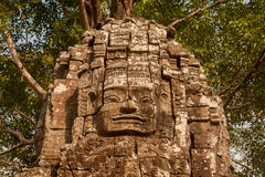 Stone face in Angkor Thom complex. Siem Reap, Cambodia Royalty Free Stock Photos