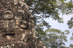 Stone face in Bayon temple in ancient city Angkor Royalty Free Stock Photography