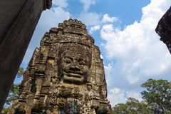 Stone Face on Bayon Temple at Angkor Thom royalty free stock images