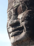 Stone face at the Bayon Temple in Cambodia Stock Photo