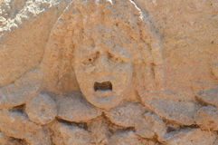 Stone face full of depression terror, agony and fear Royalty Free Stock Image