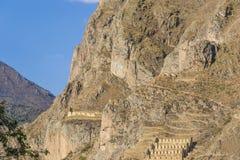 Stone Face of Inca God and Inca Ruins. Ollantaytambo - Peru Royalty Free Stock Photo
