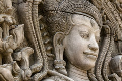 The stone face of the khmer king on the wall of  Temple,. Cambodia Royalty Free Stock Images