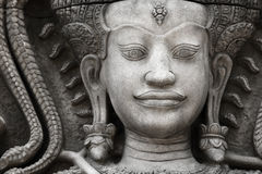 The stone face of the khmer king on the wall of  Temple,. Cambodia Royalty Free Stock Photo
