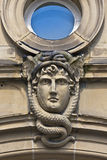 Stone face & snakes Stock Images