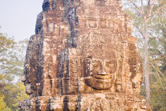 Stone face statue in ancient Bayon Temple Angkor Thom, Cambodia. Stock Photography