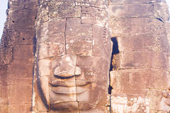 Stone face statue in ancient Bayon Temple Angkor Thom, Cambodia. Royalty Free Stock Images