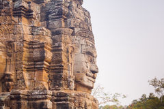 Stone face statue in ancient Bayon Temple Angkor Thom, Cambodia. Royalty Free Stock Photography