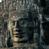 Stone face of temple Bayon in Cambodia Royalty Free Stock Photos