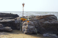 Stone face on tropical beach in Goa Royalty Free Stock Images