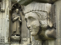 Stone faces. Carvings on the wall of Canterbury Cathedral, England Royalty Free Stock Photos